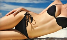 $25 for Two VersaSpa Spray Tans or Two UV Tanning Sessions in an Instant Bed at Sun Tan City ($58 Value)