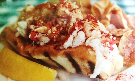 Lobster-Roll or Seafood Dinner for Two or Four at New England Seafood Co Fish Market & Restaurant (Up to 42% Off)