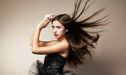 Cut with Conditioning or Color from Shayla Klinger at En Vogue Salon (Up to 54% Off). Three Options Available.
