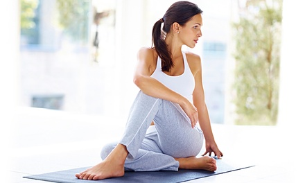 Month of Unlimited Yoga Classes or a Month of Unlimited Yoga and Spin Classes at Yoga and Beyond (Up to 86% Off)