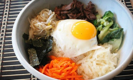 Korean Dinner with Drinks for Two or Four at KUI Korean BBQ (Up to 56% Off)