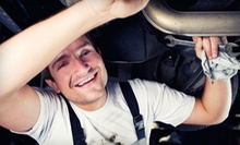 Oil Change with Tire Rotation and Inspection or Brake Pads or Shoes at Goodyear Tire Giant/Brakes Xpress (Up to 77% Off)