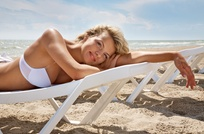 One Month of Unlimited All-Access Tanning, Custom Airbrush Tan, or Three Mystic Tans at The Tanning Spa (Up to 87% Off)