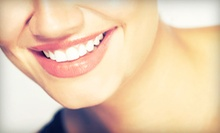 $99 for a Zoom! Teeth-Whitening Treatment at P.H.D. Salon & Spa ($199 Value)