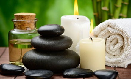 80-Minute Hot-Stone Massage or 60-Minute Hand-and-Foot Reflexology Massage at Peaceful Escape (Up to 53% Off)