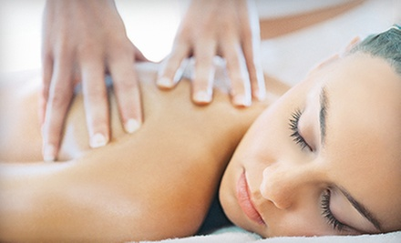 60-Minute Swedish Massage or Custom Facial at ReNue Salon & Spa (52% Off)