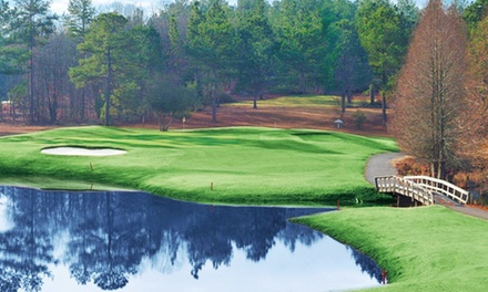 $28 for a Round of Golf Including Cart and Range Balls at Whispering Woods Golf Club (Up to $64 Value)