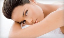 $69 for a Swedish Massage and Facial with Complimentary Glass of Wine at Sanctuary Salon &amp; Day Spa ($155 Value)
