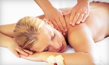 One or Three 50-Minute Swedish Massages with 15-Minute Back Scrubs at Symmetry Massage and Wellness (Up to 56% Off)