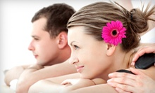 Hot-Stone or Aromatherapy Couples Massage or 60-Minute Massage for One at Studio Rejuvenate (Up to 52% Off)