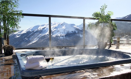 groupon daily deal - 1- or 2-Night Stay in a Standard Room with Welcome Drinks or Wine at Whistler's Inn in Jasper, AB.
