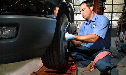 Oil-Change Package or Four-Wheel Steering Alignment at Everett Street Autoworks (Up to 58% Off)