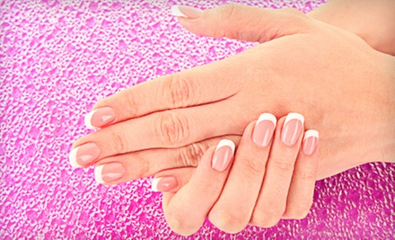 Manicure and Spa Pedicure, French Wrap and Manicure, or Set of Acrylic Nails at Dezines Hair Artistry (Up to 53% Off)