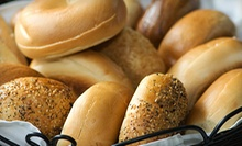 One or Two Dozen Bagels with Cream Cheese at What A Bagel (Half Off)