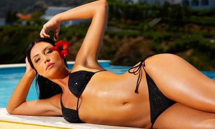 Two Spray Tans or Three or Six UV Tanning Sessions at TanV (Up to 61% Off)