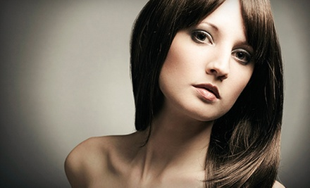 Haircut with Option of Single Color Treatment or Partial Highlights at Turning Heads Salon and Spa (Up to 52% Off)