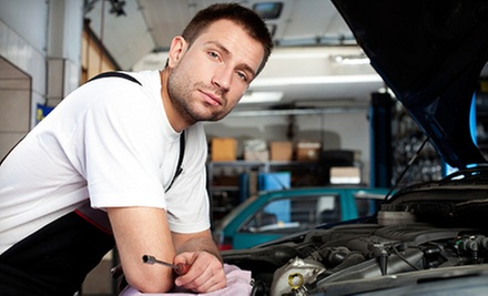 Two- or Four-Wheel Brake Service with Pads and a System Inspection at McAllisters Auto Center (Up to 63% Off)