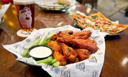 Pub Cuisine and Drinks for Two or Four at Tilted Kilt (Half Off)