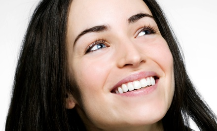 Zoom! Teeth-Whitening Treatment with Optional Custom Whitening Trays at The Smile Salon (Up to 68% Off)