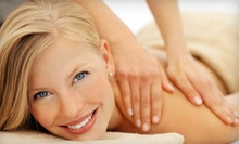 Massage and Body Wrap Packages at Escentials Massage & Spa (Up to 59% Off). Three Options Available.