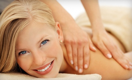 Massage and Body Wrap Packages at Escentials Massage &amp; Spa (Up to 59% Off). Three Options Available.