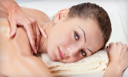 Swedish Massage, Body Scrub, or Both at Dharma Healing Center (Up to 54% Off)
