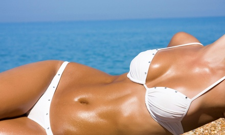 1 or 2 Spray Tans at Touché Salon (Up to 55% Off)