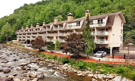 groupon daily deal - Stay at Days Inn on the River in Gatlinburg, TN, with Dates into June