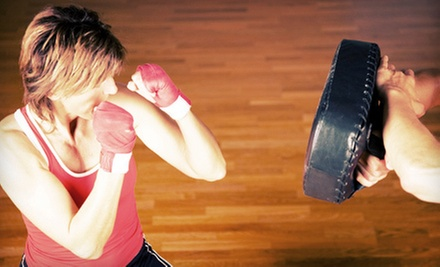 One Month of Unlimited Circuit Training and Nutritional Counseling for One or Two at 9 Round (Up to 58% Off)