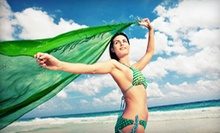 Five Sessions in a Level 2 UV Bed or Three or Five Mystic Tan Spray Tans at Element Tanning (Up to 57% Off)