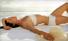 One Month of Tanning in a Level 1 or 2 Bed or a Level 3 Bed, or One or Two Spray Tans at Tanning Factory (Up to 58% Off)