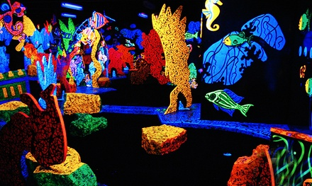 One Round of Glow-in-the-Dark Mini Golf for Two or Four at Putting Edge (Up to 52% Off)