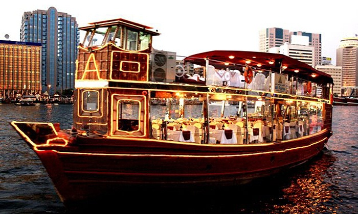 Al Faris Floating Restaurant - Multiple Locations: [Up to 61% off] Luxury Dinner Cruise in Bur Dubai aboard a Glass Enclosed Dhow for Kids or Adults starting from AED 59