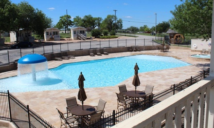 groupon daily deal - Stay at Hill Country Cottage and RV Resort in New Braunfels, TX; Dates into June.