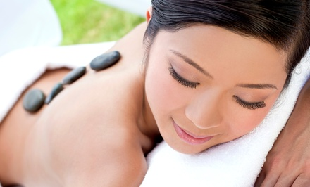 $59 for a Spa Package with One-Hour Massage and Foot Scrub at There She Glows! Day Spa ($115 Value)