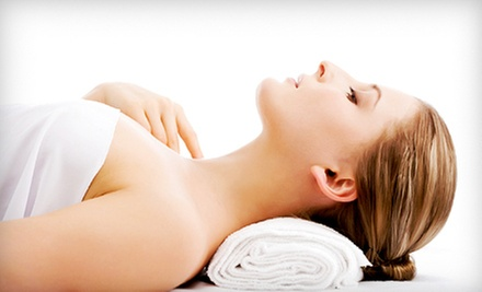 Body Wraps, Facials, or Massage at Massage, Wellness &amp; Beyond (Up to 58% Off). Three Options Available.