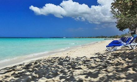 groupon daily deal - 3-, 4-, or 5-Night Stay for Two in a Standard or Superior Room at Travellers Beach Resort in Negril, Jamaica