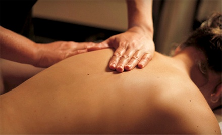 Chiropractic Exam with Electric Stimulations and One or Two Adjustments at Manhattan Wellness Group (Up to 90% Off)