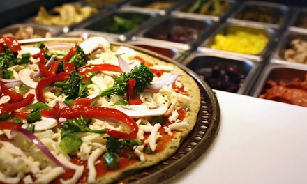Two or Three Groupons, Each Good for $10 Worth of Build-Your-Own Pizza at Pizza Studio (Up to 50% Off)