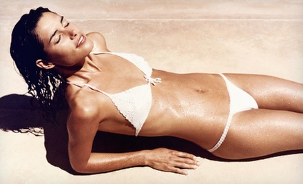 Three Spray Tans or Three Months of UV-Bed Tanning, or Haircut and Color at Fever Hair Design & Tanning (Up to 57% Off)