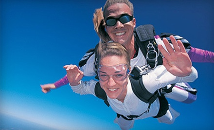 Tandem-Skydiving Package with Photos, T-shirt, Wine, and Extras for One or Two from Skydive Door County (Up to 42% Off)