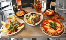 Wood-Fired Pizza or Pasta Meal for Two or Four with Salad, Sangria, and Dessert at Red Tomato Pizza (Up to 59% Off)