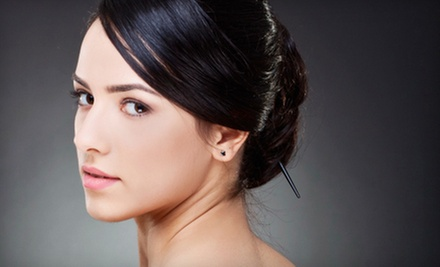 One, Three, or Six Anti-Aging Facials with Microdermabrasion at Texas Tan & Spa (Up to 87% Off)