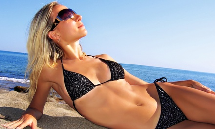 Two Norvell Airbrush Tans, Three VersaSpray Spray Tans, or One Month of UV Tanning at Boca Tanning Club (Up to 79% Off)