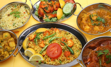 Three-Course Weeknight Meal for Two or Four, or $20 Worth of Food at New Delhi Palace (Up to 54% Off)