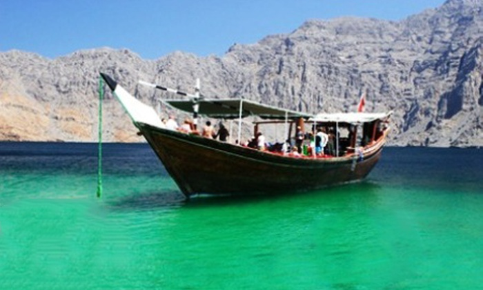 Saluja Tourism - Bur Dubai: Musandam Cruise with Lunch Buffet & Activities for up to 4 people starting from AED 195