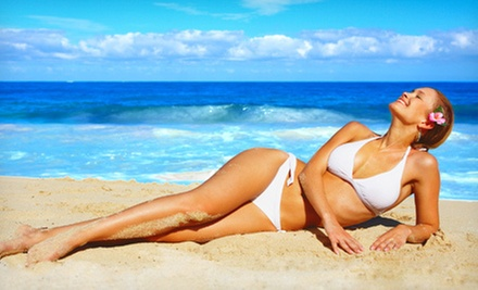 One Month of Unlimited Tanning or One or Three UV-Free Spray Tans at Tan Central (Up to 67% Off) 