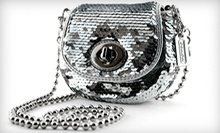 Authentic Designer Handbags at Carried Away (Half Off). Two Options Available.