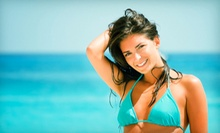 Bed Tanning or Spray Tans at Sunsations Tanning Plus (Up to 54% Off). Four Options Available.