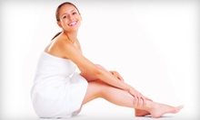$49 for a Therapeutic Massage with Hot Towels and Paraffin Dip at A Touch of Heaven Salon Massage & Day Spa ($125 Value)